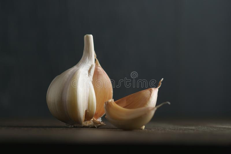 Garlic and garlic cloves on dark royalty free stock image