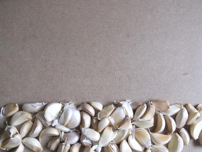 Garlic Cloves on the MDF wooden plate board Texture Background with copy space for your text royalty free stock images
