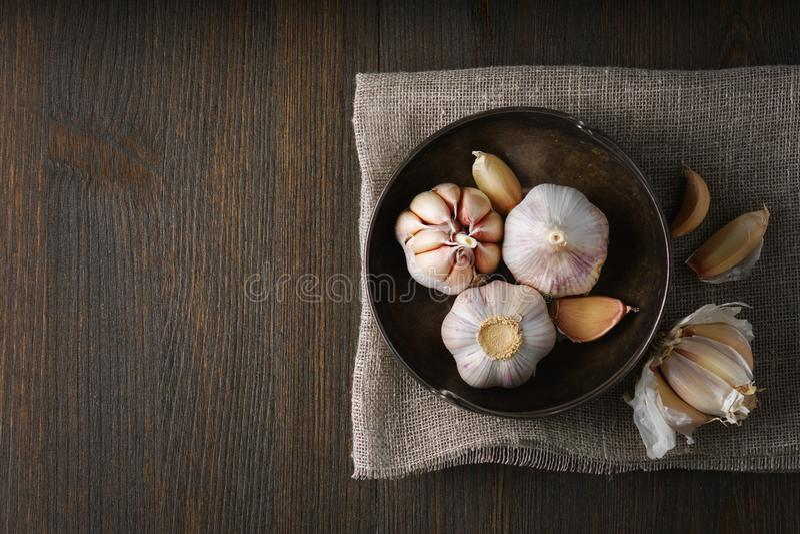 Garlic and garlic cloves on dark royalty free stock photos