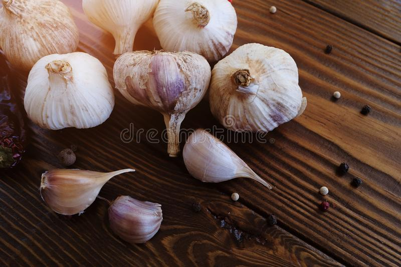 Garlic, garlic cloves and spices on a wooden table. Natural seasoning. Antibacterial, boosts immunity. The concept of nutrition,. Alternative medicine against royalty free stock photography