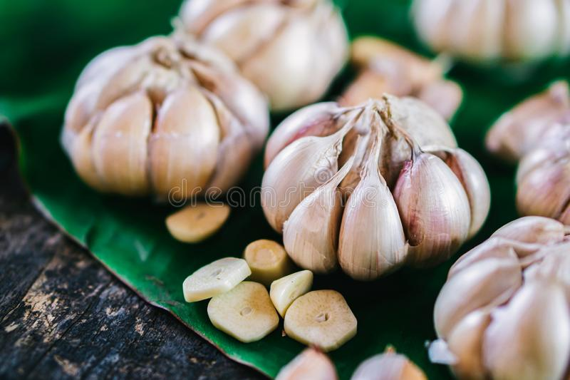 Garlic cloves on wooden table stock photos