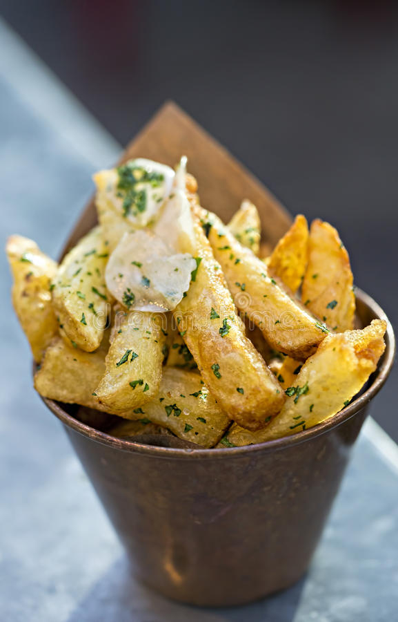 Garlic french fries. On the table royalty free stock photos