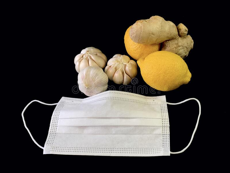 Garlic, ginger and lemon on a black background. Natural vitamins, antibiotics on a dark table. Concept: prevention of viral. Infections and corovirus at home stock image