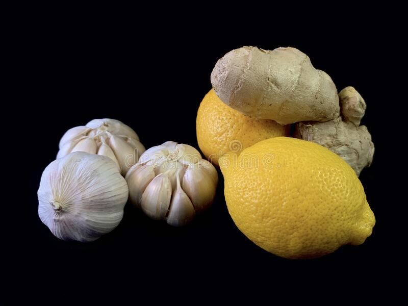Garlic, ginger and lemon on a black background. Natural vitamins, antibiotics on a dark table. Concept: prevention of viral. Infections and corovirus at home stock photography