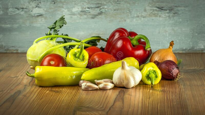 Garlic Beside Ginger and Pepper on Brown Wooden Table royalty free stock photo