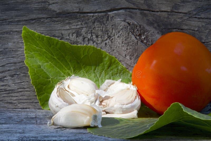 Garlic, horseradish leaf, tomato royalty free stock photos