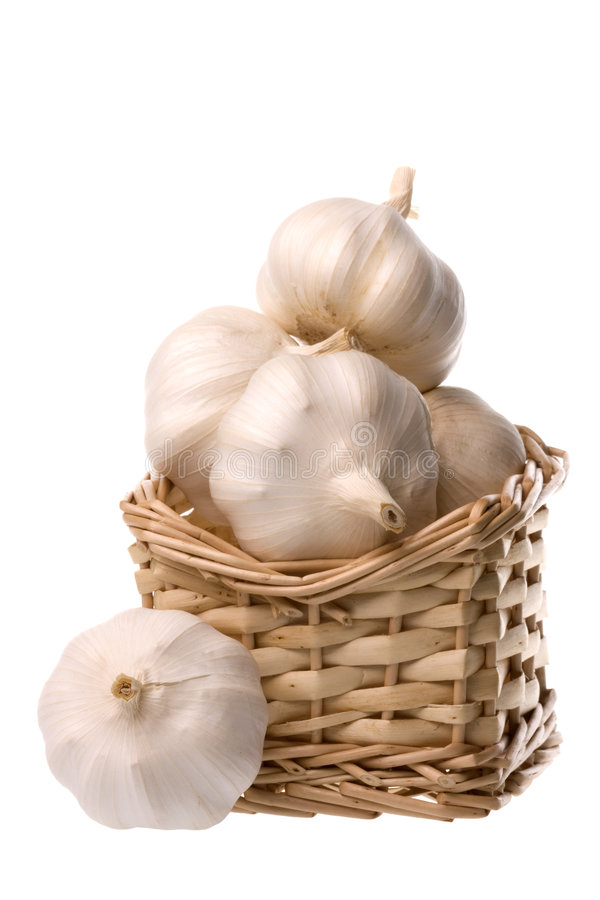 Garlic Isolated. Isolated image of garlic in a basket stock photography