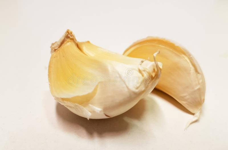 Garlic isolated in white background slice and whole. For food background royalty free stock image