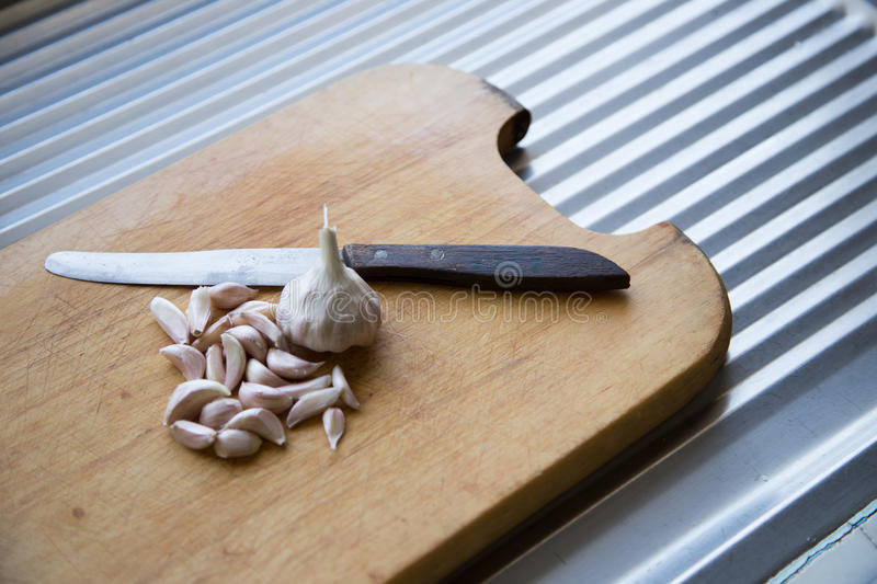 Garlic with knife stock photo