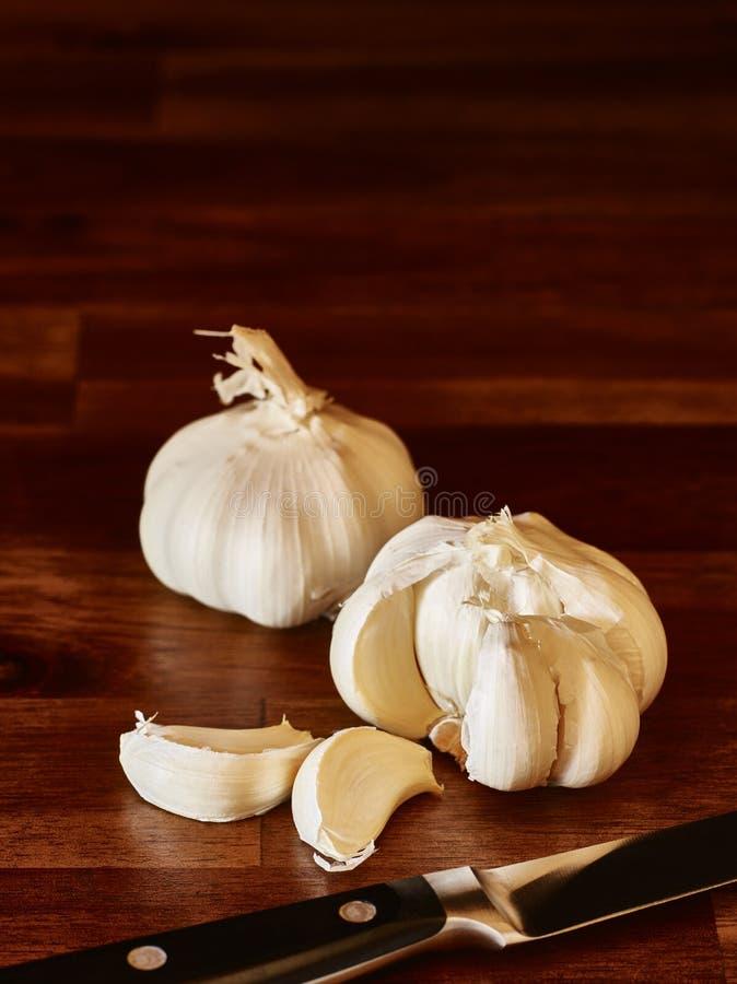 Garlic and knife royalty free stock image