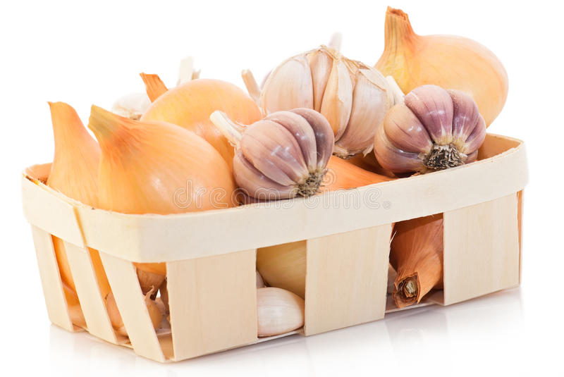Garlic and onion. Food ingredient: Garlic and onion at wooden basket. Sdof stock image