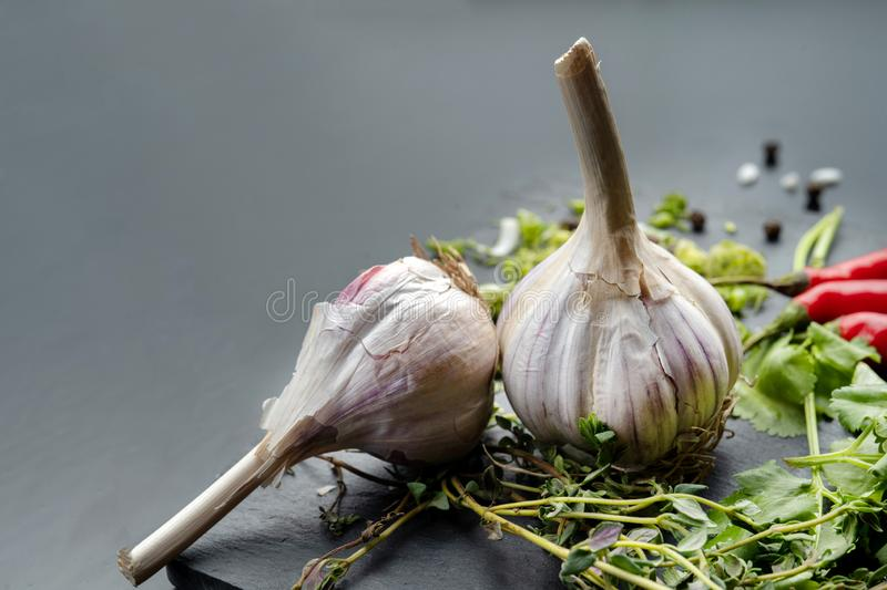 Garlic and onion on the black slate. Clouse-up royalty free stock images