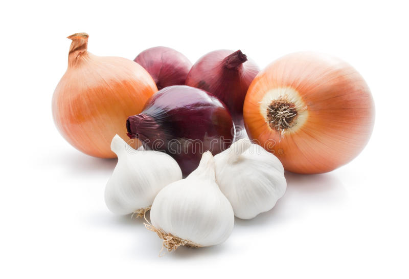 Garlic and onions. Arrangement of different varieties of onions with garlic close-up isolated on white background royalty free stock photos