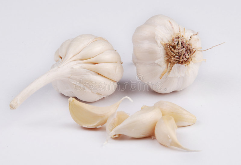 Garlic pieces stock photography