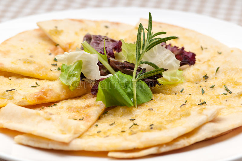 Garlic pita bread pizza with salad on top stock photography