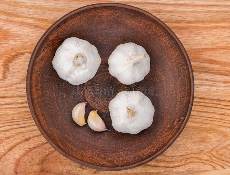 garlic in a plate stock photos