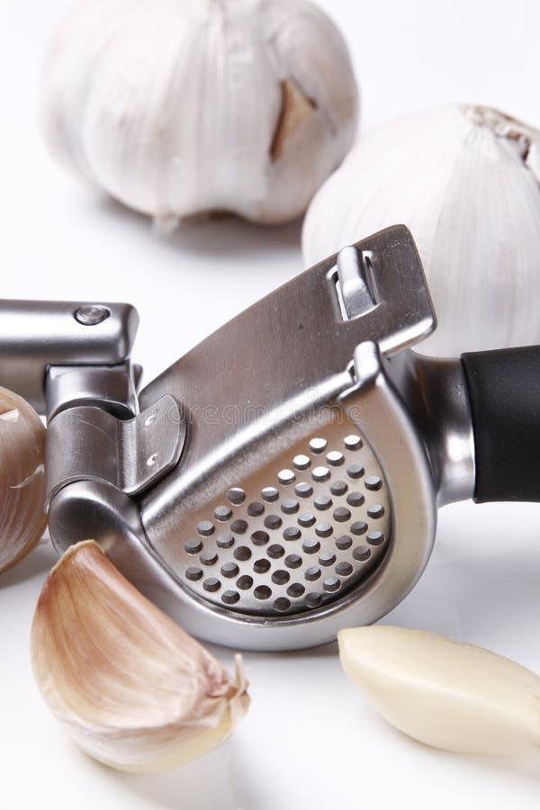 Garlic press and garlic stock photography