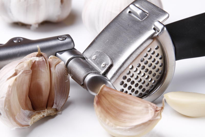 Garlic press and garlic royalty free stock photos