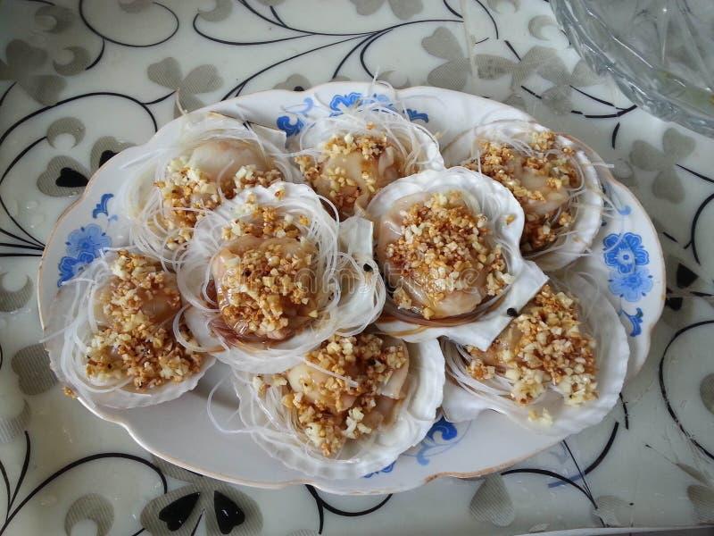 Garlic scallops royalty free stock photos