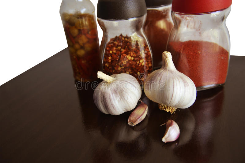 Garlic, spices and condiments for food right stock image
