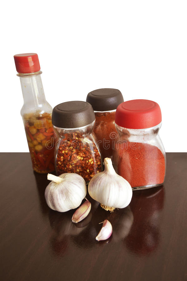 Garlic, spices and condiments for food vertical top royalty free stock photography