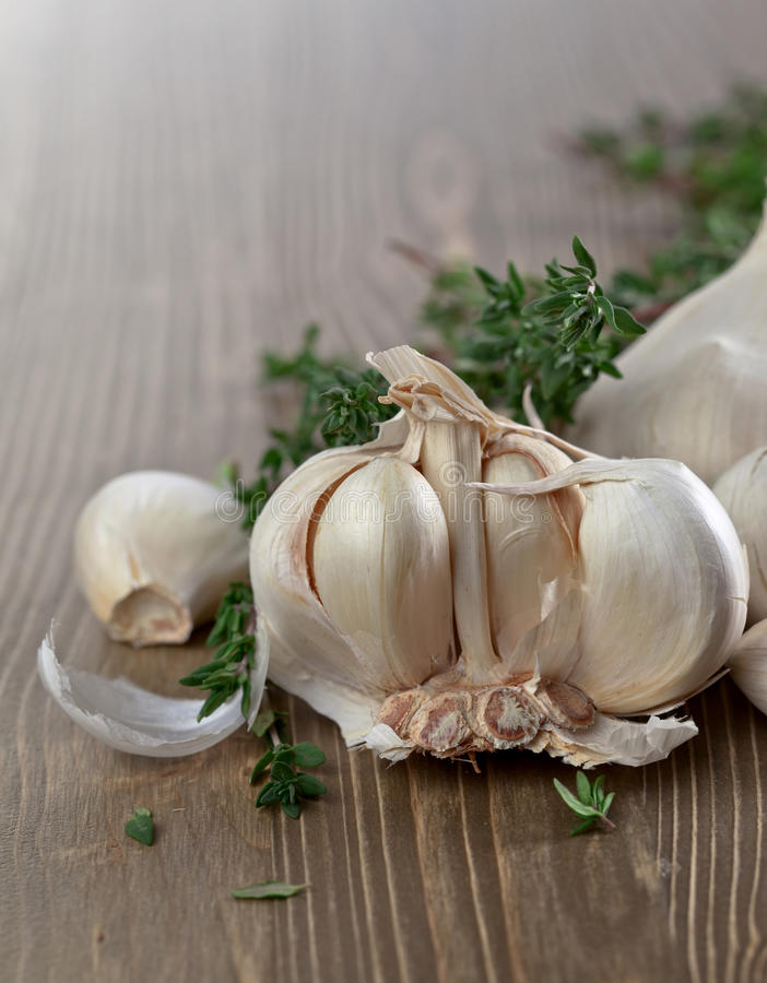 Garlic and thyme. On old wooden table royalty free stock image