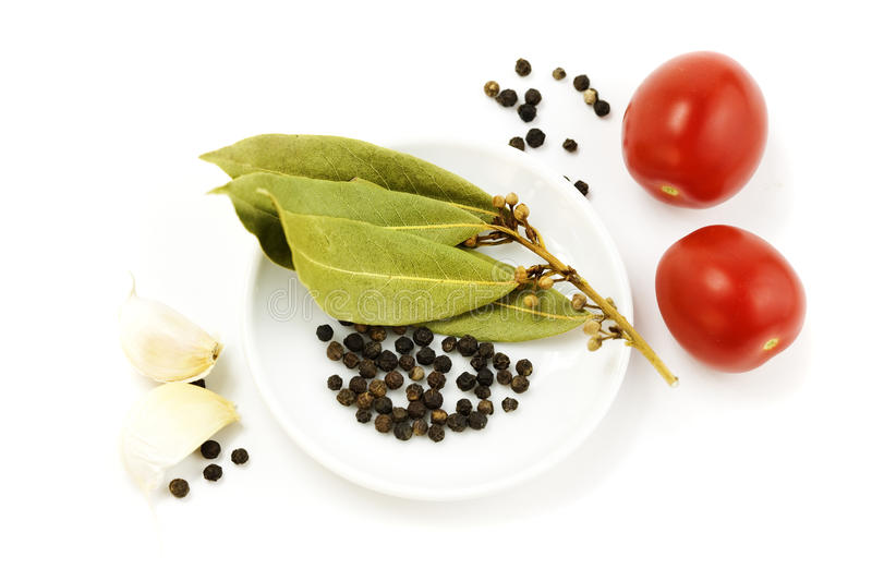 Garlic, tomato, peppercorn and bay leaf stock image