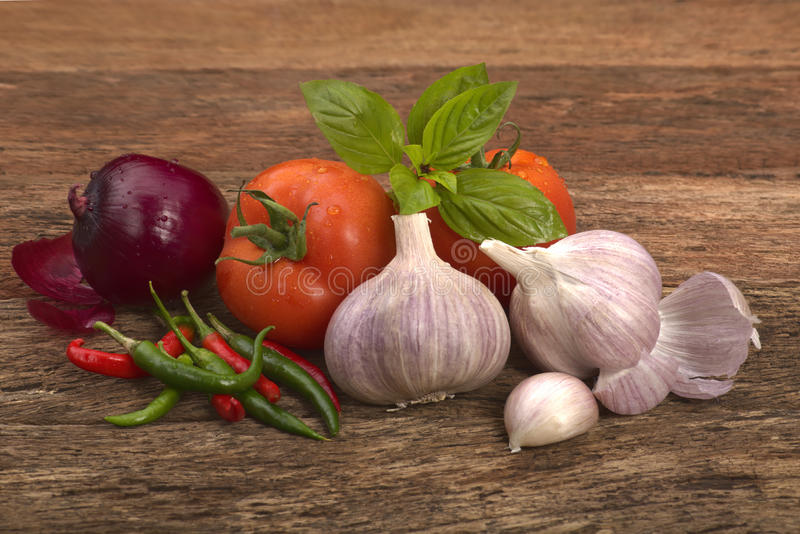 Garlic tomato red onion chilli and basil leaves stock image