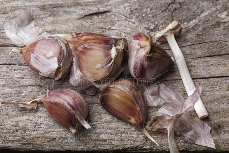 Garlic on the table. Garlic on the vintage wooden table stock photos