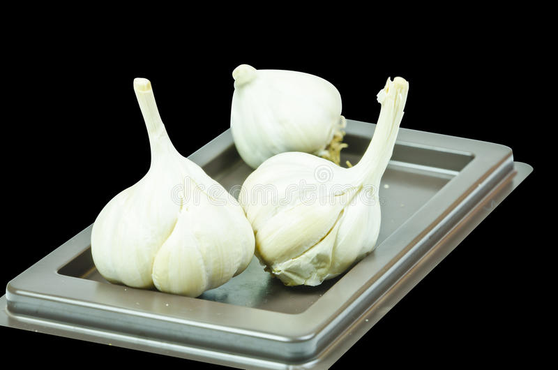 Download Garlic Is On White Background  Isolated Stock Photo - Image: 29477370