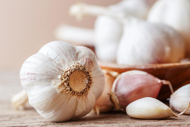 Garlic cloves and garlic bulb on a white wooden table royalty free stock photos