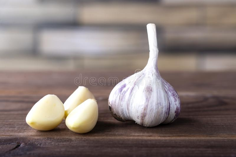 Garlic on a wooden table. Healthy spices, healthy food stock photo