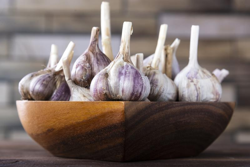 Garlic on a wooden table. Healthy spices, healthy food royalty free stock photography