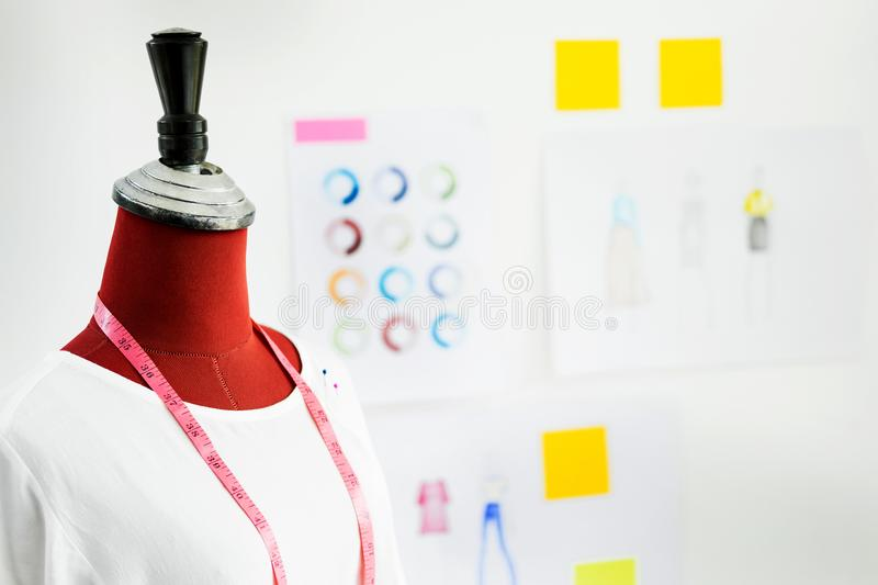 garment design on mannequin Red dummy with measuring tape in tailors fashion designer studio, Creative Design and Artistic Concept stock image