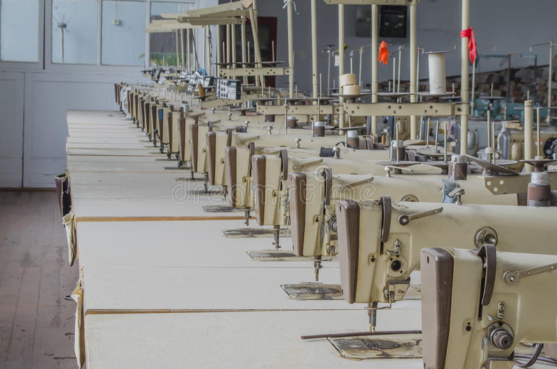 Garment factory with the old equipment royalty free stock photos