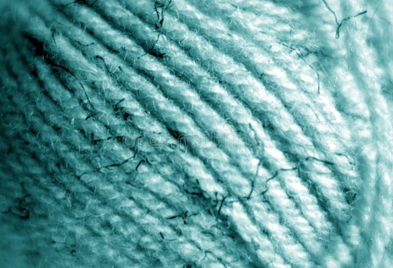 Garnballnahaufnahme mit Unschärfeeffekt in der cyan-blauen Farbe stockfotos