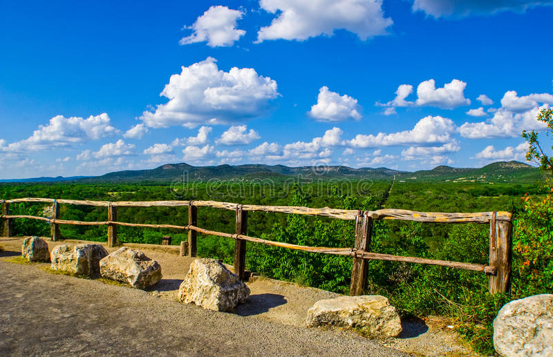 Garner state park overlook Texas Hill Country. West of san antonio on the frio river. Partly cloudy skies and a wooden fence holden back idiots that might fall royalty free stock images