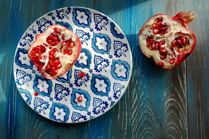 Garnet on plate with blue and white plate stock images