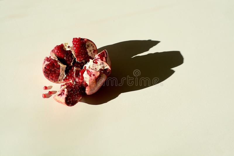 Ripe red juicy pomegranate. Grains pomegranate fruit. Pomegranate cut in the form of a star. royalty free stock image