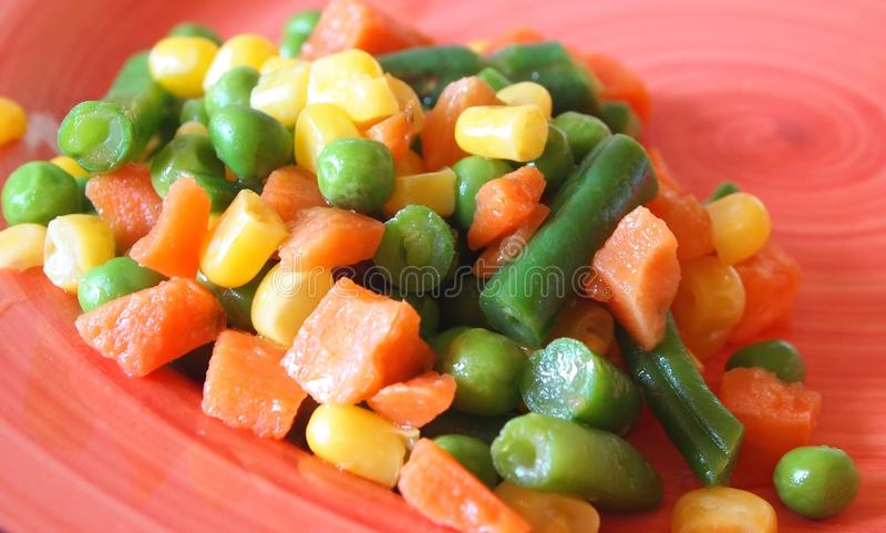 Garnish. With carrot, corn, pea and string beans stock images
