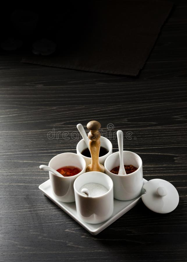Garnish set for noodle Thai Food, chilly sugar fish sauce on the table  in restaurant royalty free stock photography