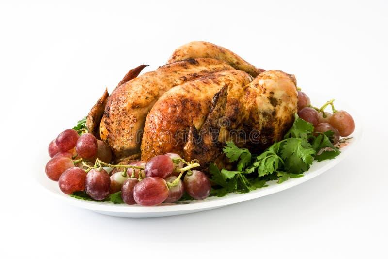 Garnished烤了火鸡用葡萄和草本 图库摄影