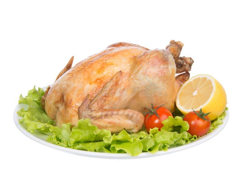Garnished asó el pollo de la acción de gracias en una placa