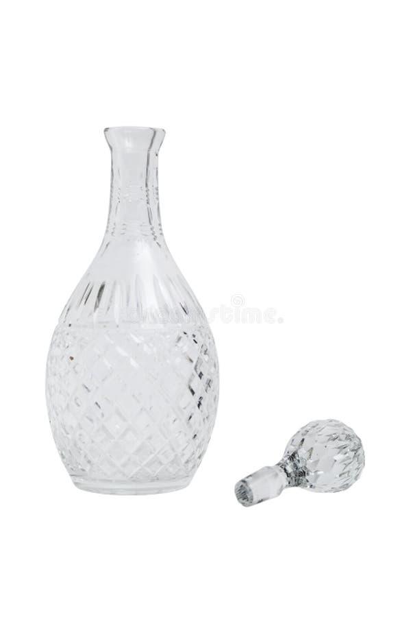 Garrafa bonita vazia transparente de vidro com a tomada no fundo isolado imagens de stock