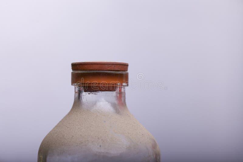 Garrafa com areia foto de stock
