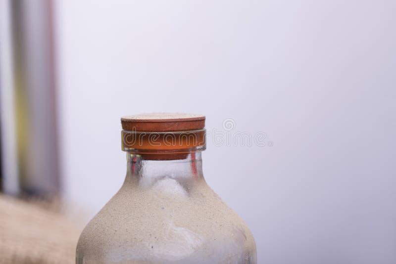 Garrafa com areia imagem de stock