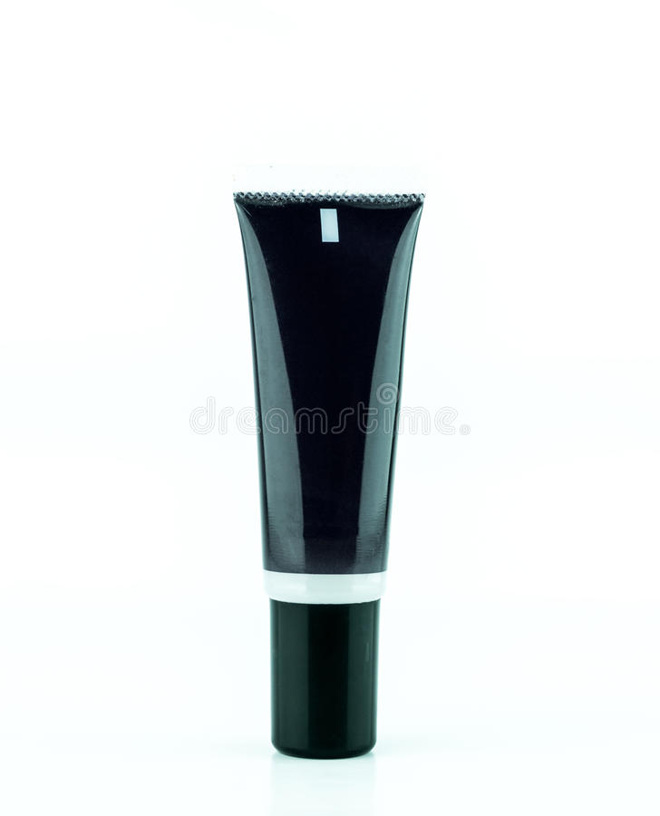 Garrafa de creme preta vazia do tubo ou do cosmético isolada no fundo branco imagens de stock