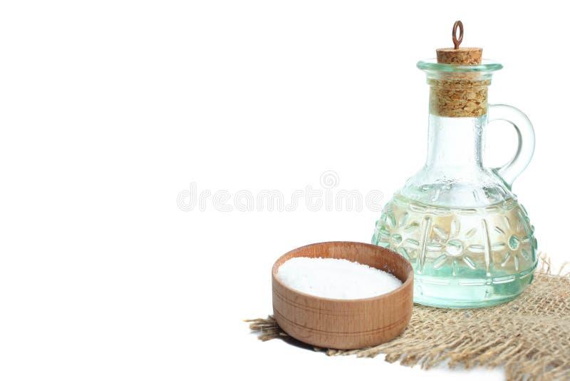 Garrafa de vidro com óleo e sal imagem de stock royalty free