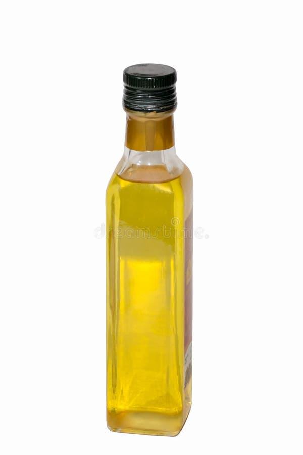 A garrafa de vidro do óleo no fundo branco fotografia de stock