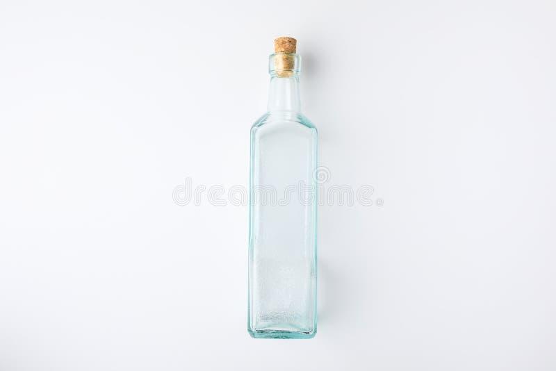 Garrafa de vidro transparente com tomada fotografia de stock